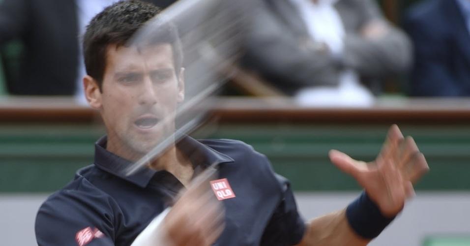 03.jun.2014 - Novak Djokovic rebate a bola durante partida contra Milos Raonic