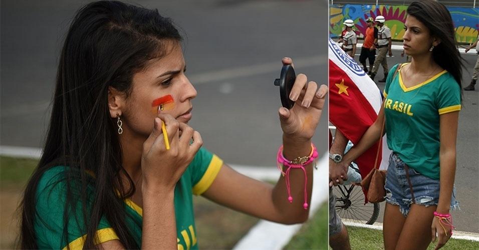 13.jun.2014 - Torcedora com camiseta do Brasil se encaminha para a arena Fonte Nova, para ver Espanha x Holanda