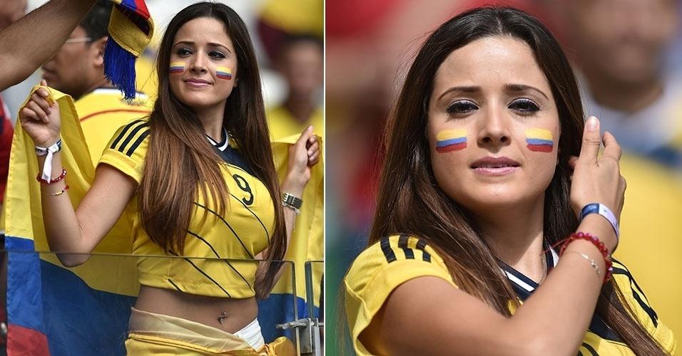 14.jun.2014 - De barriga de fora e piercing no umbigo, torcedora da Colômbia vai ao Mineirão de cara pintada para apoiar o time contra a Grécia