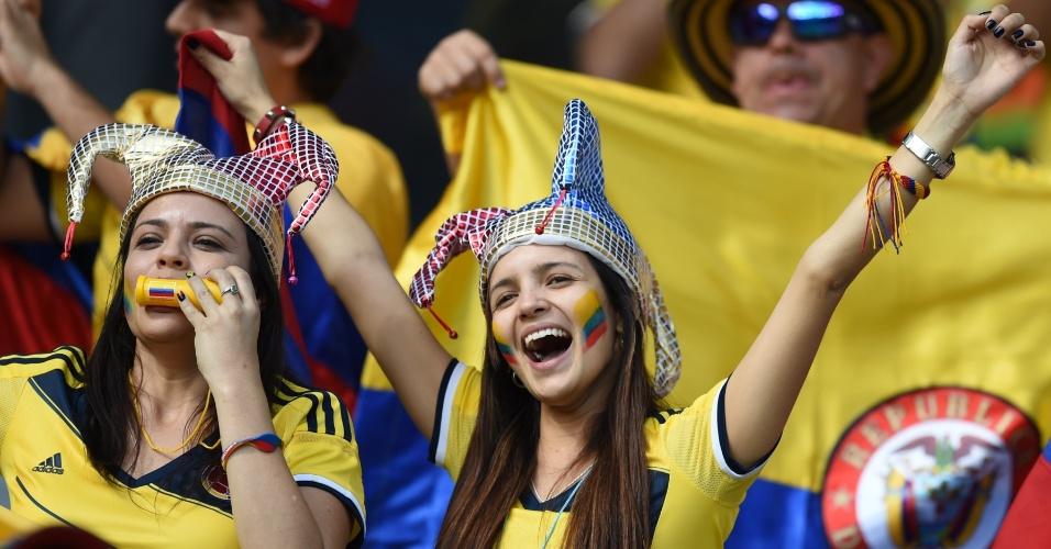 14.jun.2014 - Os rostos pintados foram uma das apostas principais da mulherada no Mineirão