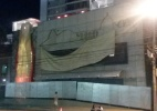 Protesto volta a assustar patrocinador da Copa, e marca é escondida (Foto: Vinicius Konchinski/UOL)