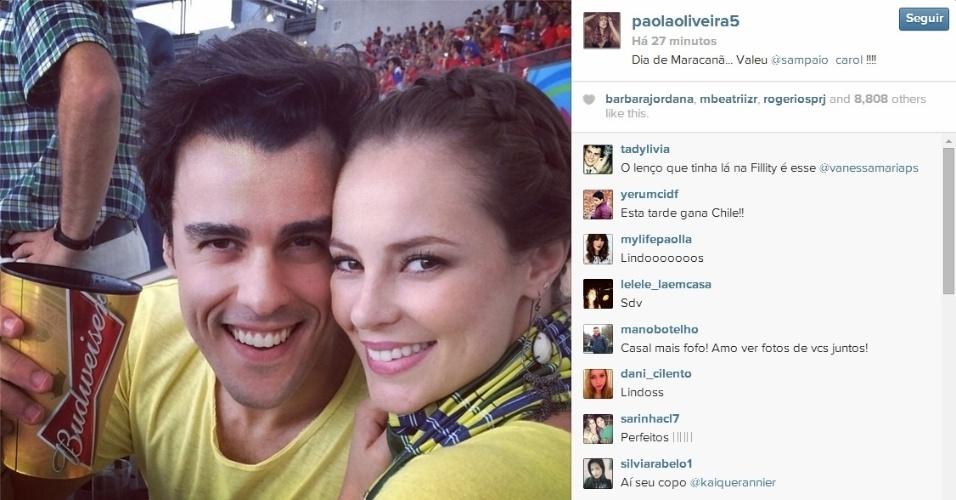 Atores Paolla Oliveira e Joaquim Lopes acompanham juntos partida entre Espanha e Chile