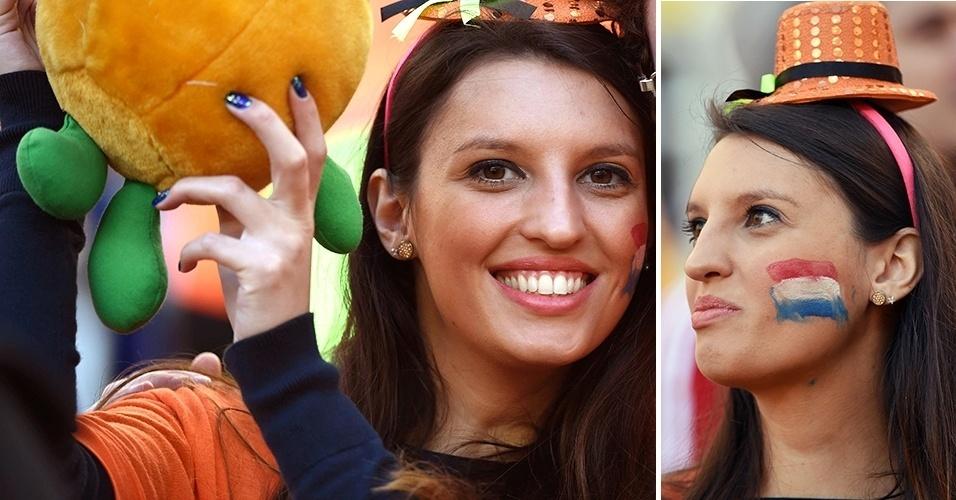 Sorridente, torcedora capricha no chapéu laranja para acompanhar o duelo da Holanda com a Austrália