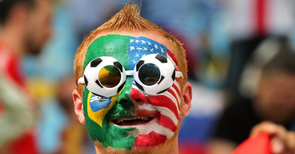 Torcedor que foi ver Bélgica e Rússia no Maracanã pintou o rosto com as bandeiras do Brasil e dos EUA