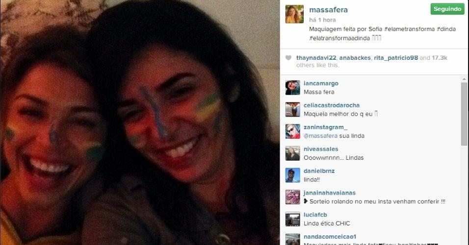 23.jun.2014 - Grazi Massafera até pintou o rosto com as cores do Brasil para torcer pela seleção contra Camarões