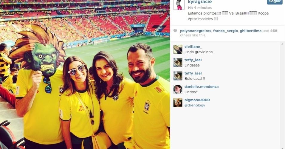 Kyra Gracie e Malvino Salvador marcam presença no Mané Garincha para assistir Brasil e Camarões