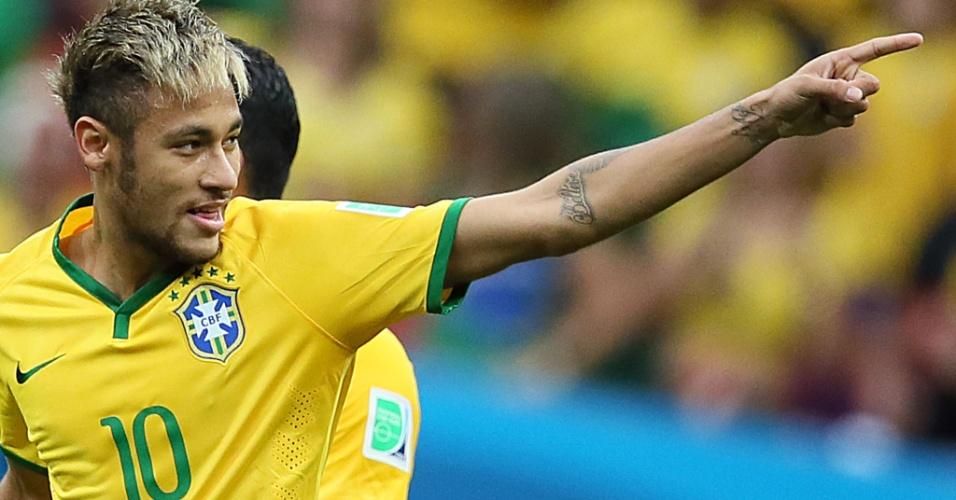 23.jun.2014 - Neymar sorri depois de abrir o placar para o Brasil contra Camarões, no estádio Mané Garrincha