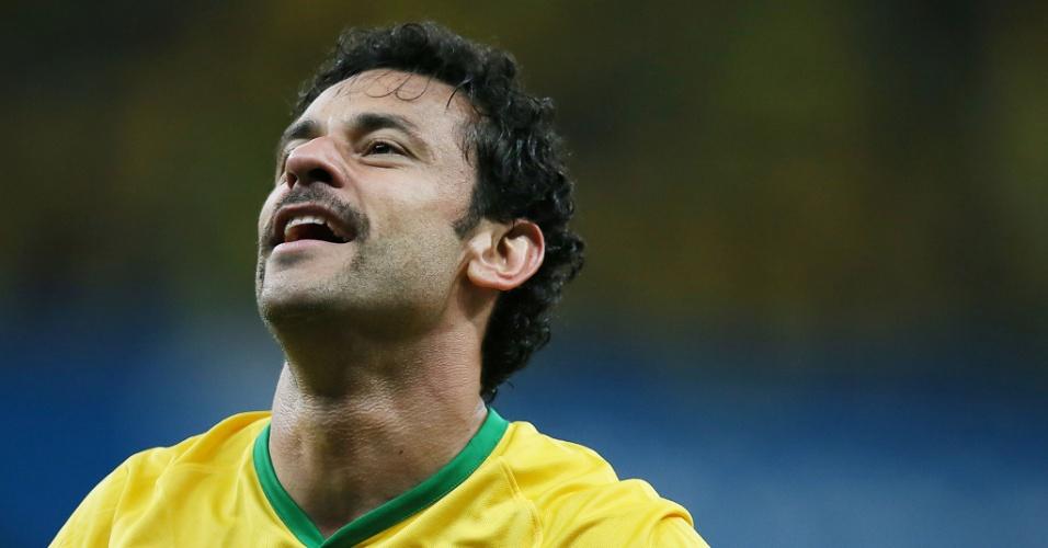 23.jun.2014 - O bigode deu sorte. Fred comemora após marcar o terceiro gol do Brasil na vitória por 4 a 1 contra Camarões