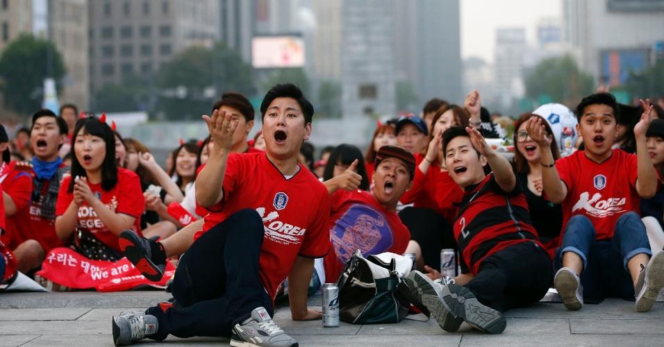 Em Seul, sul-coreanos lamentam chance de gol perdida pela seleção nacional na partida que terminou com derrota por 1 a 0 para a Bélgica