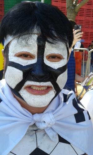 Torcedor com o rosto pintado vai ao Itaquerão acompanhar o jogo entre Coreia do Sul e Bélgica