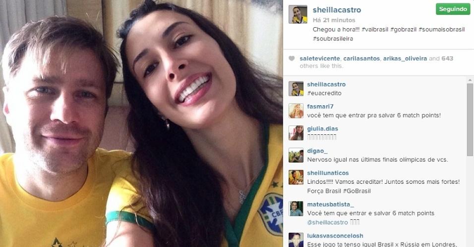 Sheilla Castro, da seleção brasileira de vôlei, mostra torcida pelo Brasil contra o Chile