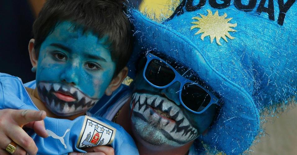 28.jun.2014 - Até o garoto entrou na onda das homenagens a Luis Suárez e teve seu rosto pintado