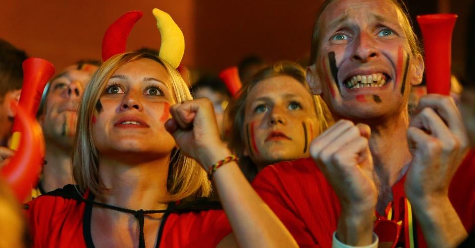 Torcedores belgas comemoram de Bruxelas a classificação às quartas de final após vitória sobre os Estados Unidos na prorrogação