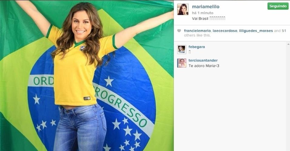 04.jun.2014 - Ex-BBB Maria Melilo mostra seu apoio ao Brasil para o jogo contra a Colômbia, pelas quartas de final da Copa