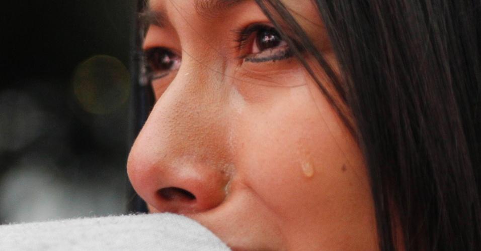 Torcedora colombiana em Bogotá chora eliminação para o Brasil na Copa do Mundo