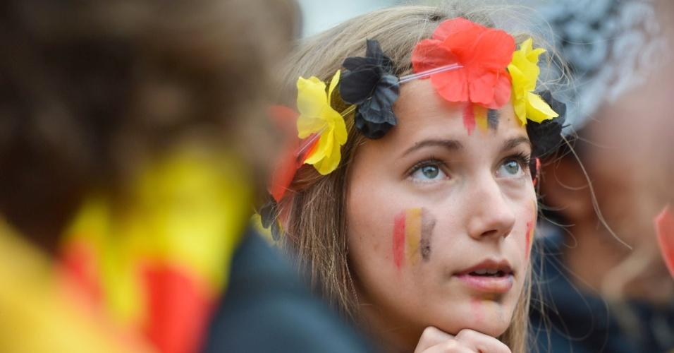 Em Bruxelas, torcedora parece não acreditar na derrotada da Bélgica para a Argentina, nas quartas de final da Copa do Mundo