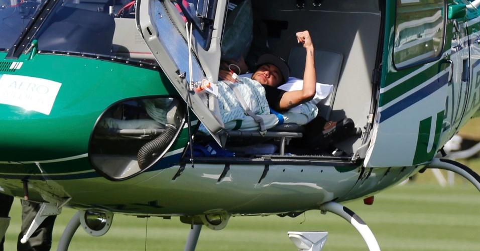 Neymar acena enquanto deixa a Granja Comary de helicóptero