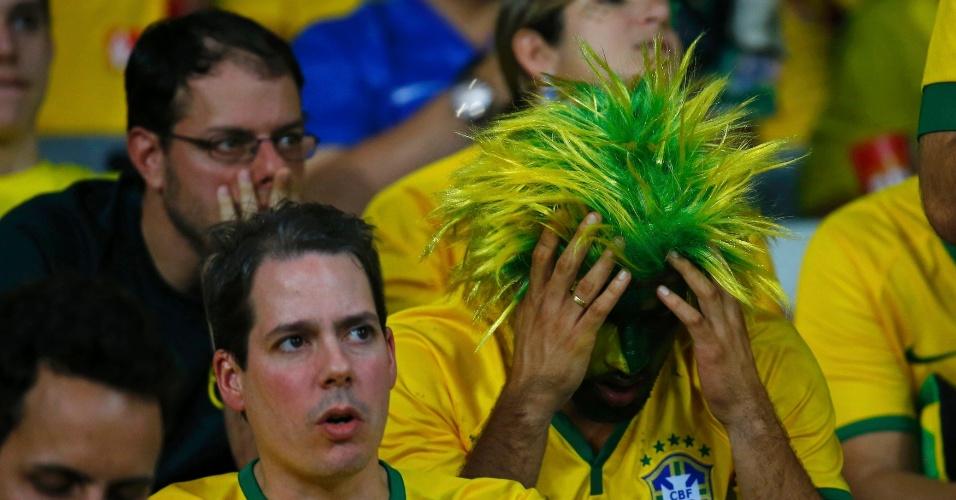 Torcedores na arquibancada do Mineirão parecem não acreditar em goleada alemã sobre o Brasil