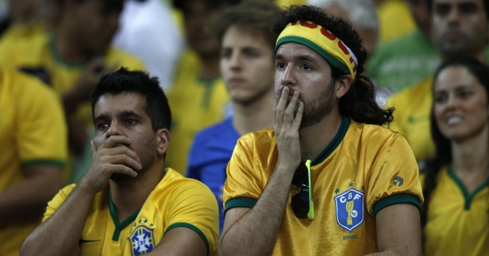 Torcedores no Mineirão assistem com tristeza Brasil ser goleado pela Alemanha