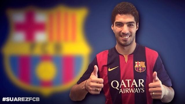 11. jul. 2014 - O Barcelona divulgou em seu site uma imagem de Luis Suárez com a camisa do time catalão
