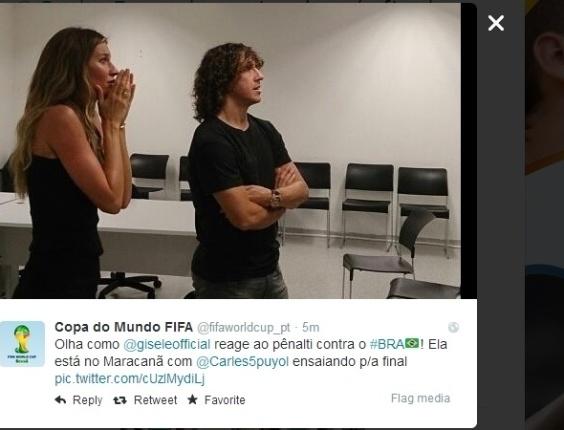 No Maracanã para o ensaio da cerimônia de encerramento da Copa, Gisele Bündchen e Carles Puyol assistem ao jogo entre Brasil e Holanda
