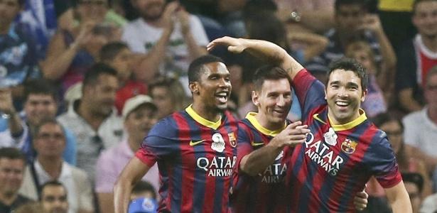 Messi com Eto'o e Deco em jogo amistoso; camaronês brincou e elogiou o argentino
