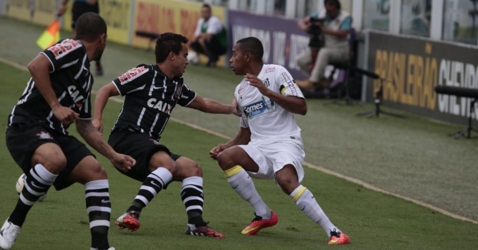 Robinho dá sua primeira finta em sua volta ao Santos, sobre Jadson, do Corinthians