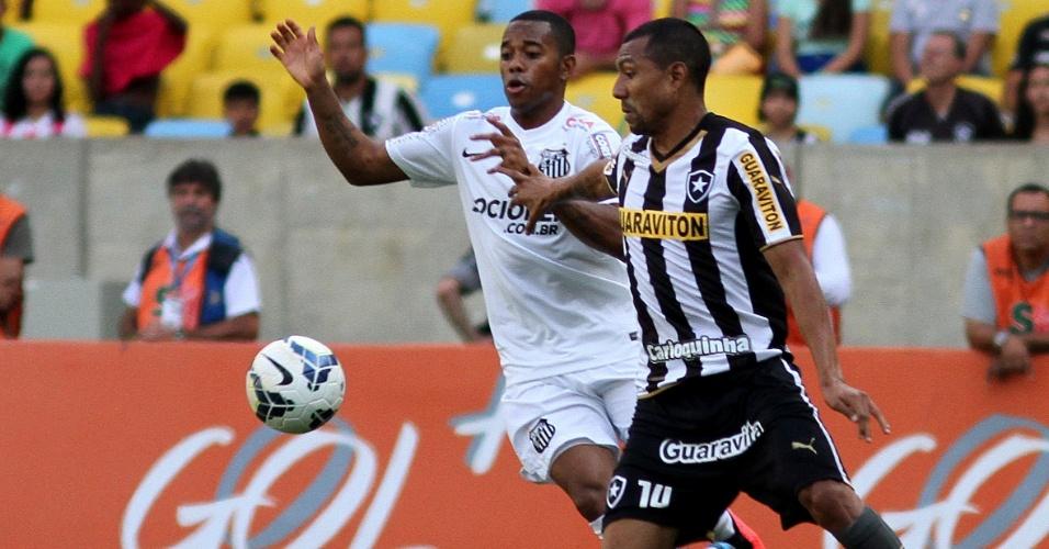 Robinho briga com Ramírez pela posse de bola durante partida entre Botafogo e Santos pelo Campeonato Brasileiro