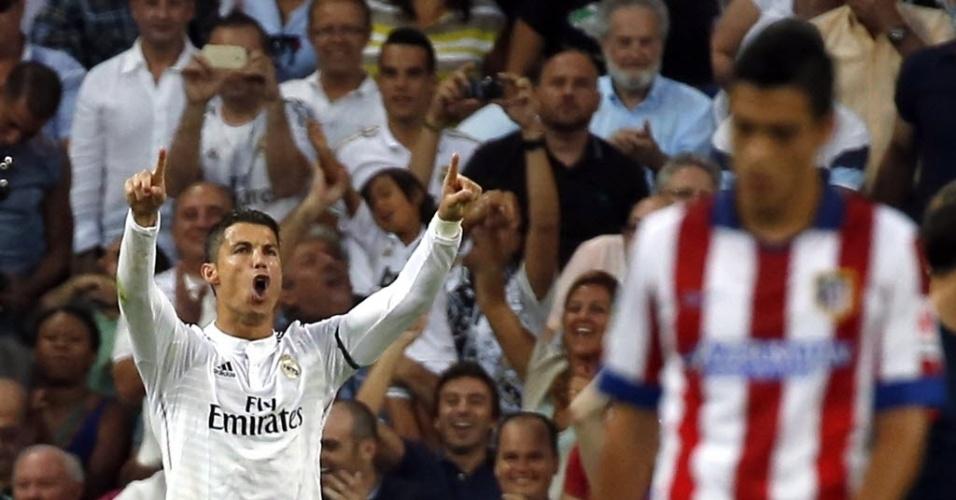 13.set.2014 - Cristiano Ronaldo comemora após marcar de pênalti Real Madrid contra o Atlético de Madri no Espanhol