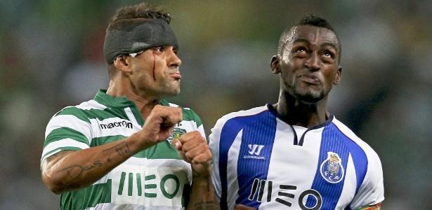 Ex-palmeirense Mauricio com Jackson Martinez em duelo pelo Português - MIGUEL A. LOPES/Efe