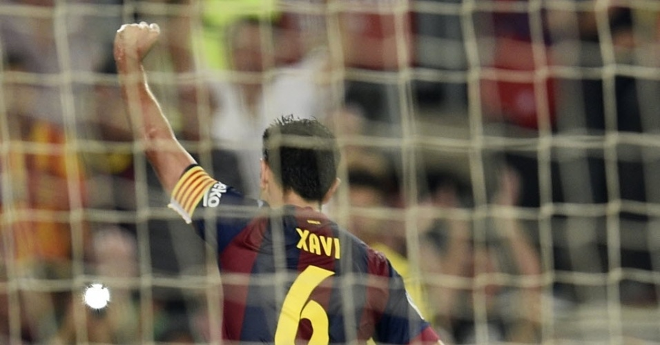 18.out.2014 - Xavi comemora após marcar para o Barcelona na partida contra o Eibar pelo Campeonato Espanhol