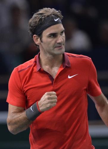 Roger Federer comemora ponto sobre Jeremy Chardy