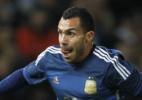 Argentina vira com Messi e vence a Croácia. Tévez volta após três anos - IAN KINGTON / AFP