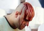 Clássico na Sérvia termina sangrento após briga entre torcidas rivais