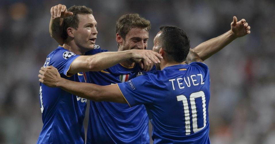 Tevez comemora classificação para a final da Liga dos Campeões com Marchisio e Lichsteiner