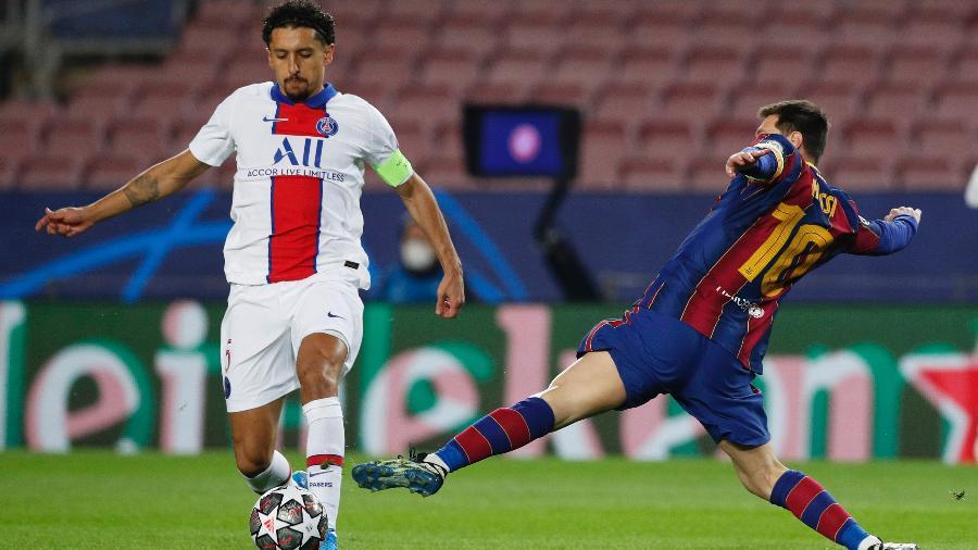Marquinhos e Lionel Messi disputam bola durante PSG x Barcelona, válido pelas oitavas de final da Liga dos Campeões - Albert Gea/Reuters