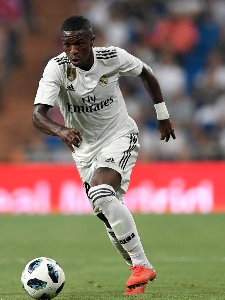 Vinicius Jr, durante partida entre Real Madrid e Milan - GABRIEL BOUYS / AFP