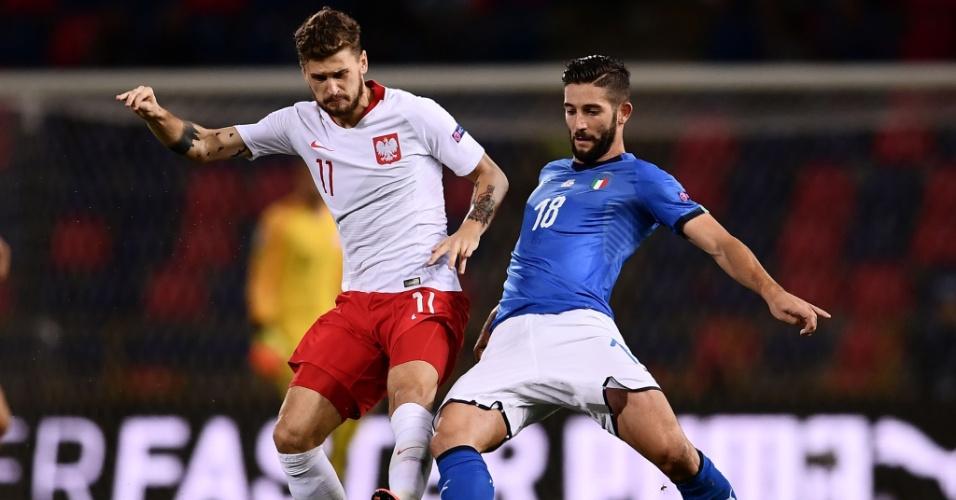 Meia polonês Mateusz Klich disputa bola com Roberto Gagliardini, da Itália, no jogo de estreia da Liga das Nações