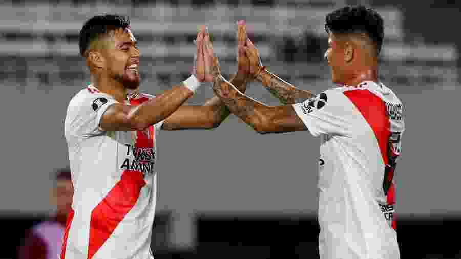 Paulo Diaz e Jorge Carrascal comemoram um dos vários gols do River sobre o Binacional - REUTERS/Agustin Marcarian