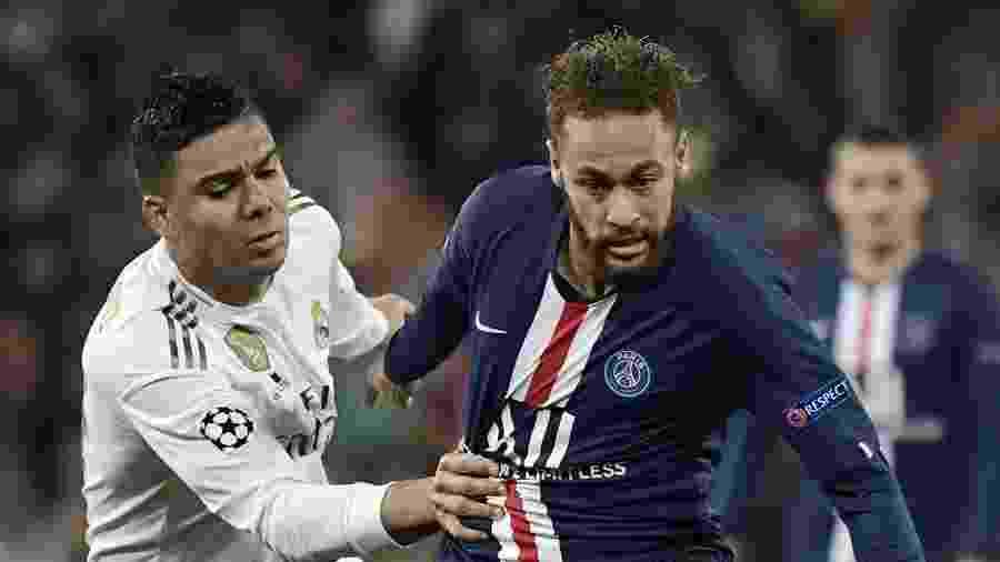 Neymar e Casemiro, durante partida entre Real Madrid e PSG - JAVIER SORIANO / AFP
