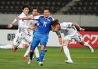Vira 5, acaba... 14! Japão massacra Mongólia pelas Eliminatórias - ISSEI KATO/REUTERS