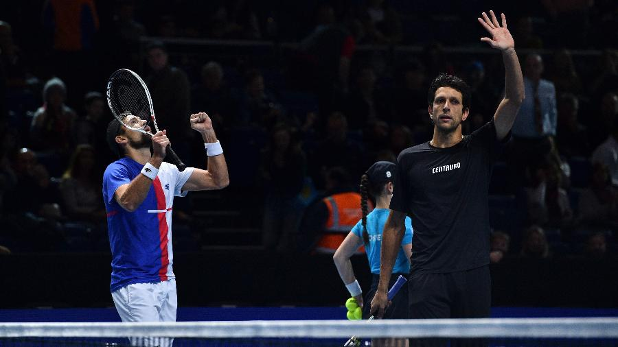 Marcelo Melo comemora vitória nas duplas Finais da ATP  - AFP PHOTO / Glyn KIRK
