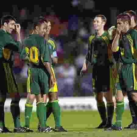 Jogadores da Austrália conversam durante a vitória por 31 a 0 sobre Samoa Americana - Darren England/Getty Images - Darren England/Getty Images
