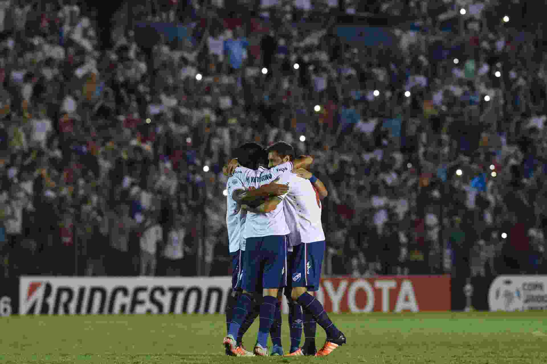 Jogadores do Nacional-URU comemoram a vitória sobre o Palmeiras - PABLO PORCIUNCULA/AFP