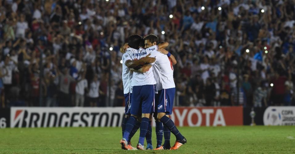 Jogadores do Nacional-URU comemoram a vitória sobre o Palmeiras