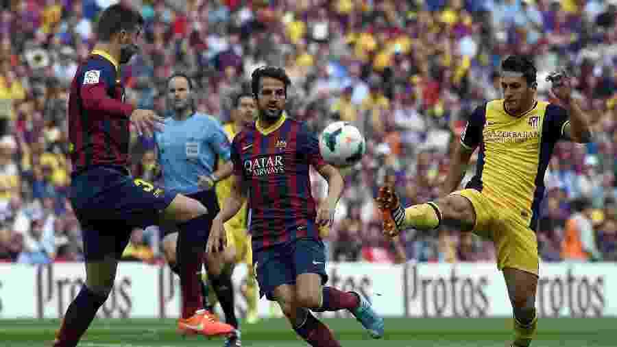 Barcelona e Atlético de Madri decidiram o Campeonato Espanhol em 2014 na última rodada - AFP PHOTO/ LLUIS GENE