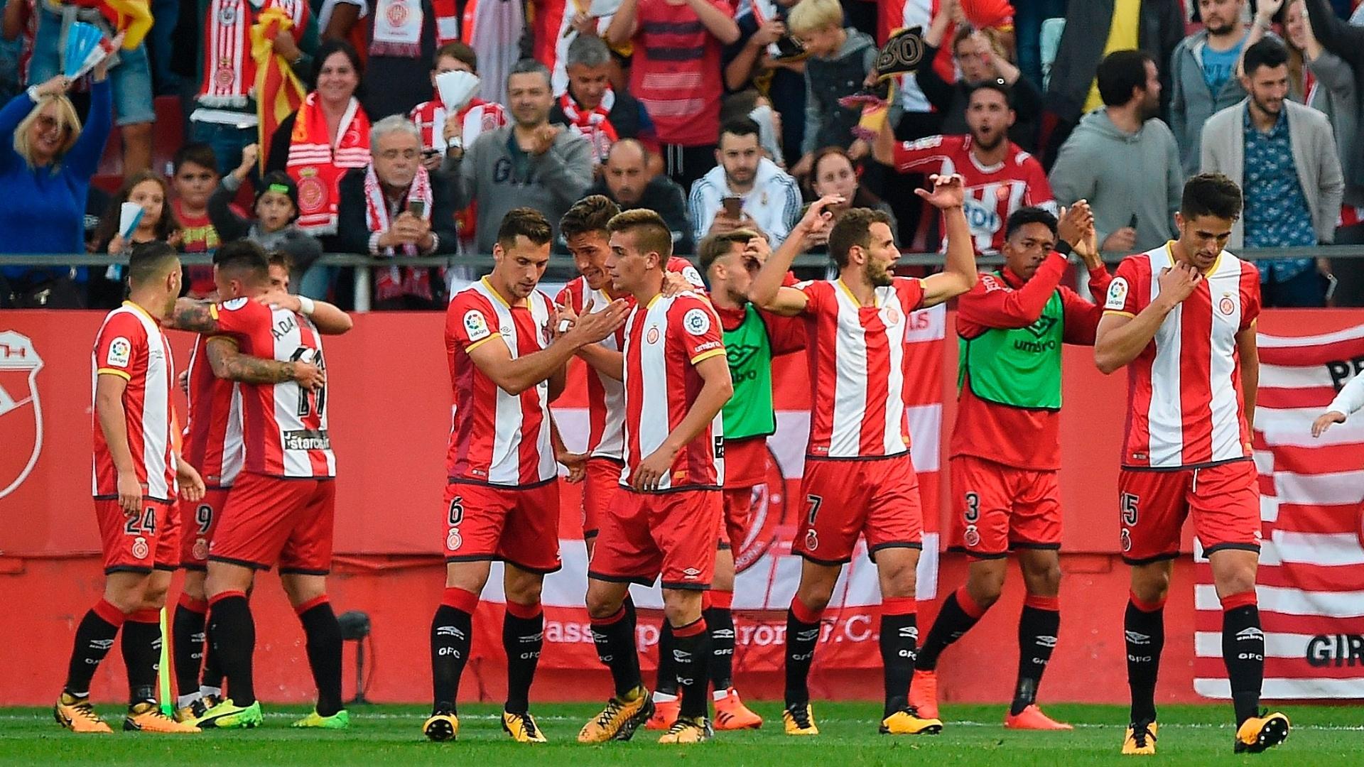 Jogadores do Girona comemoram um dos gols sobre o Real Madrid