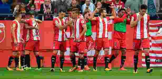 Jogadores do Girona comemoram um dos gols sobre o Real Madrid - Josep Lago/AFP Photo - Josep Lago/AFP Photo