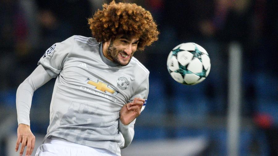 Fellaini em ação pelo Manchester United contra o Basel - Fabrice Coffrini/AFP