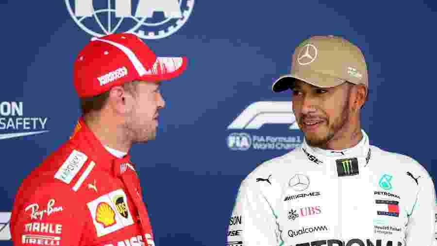 Vettel e Hamilton conversam após treino classificatório do GP dos EUA - Charles Coates/Getty Images/AFP